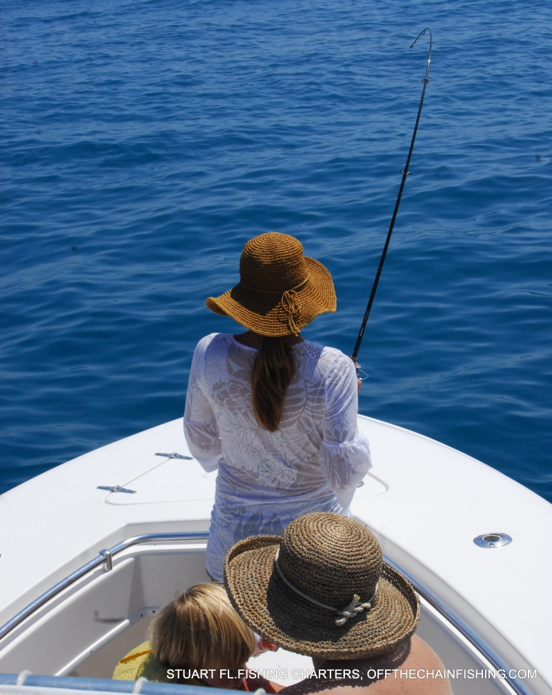 Heather, tight on a huge permit. Florida light tackle fishing charters. Spring and summer permit, tarpon, and cobia charters